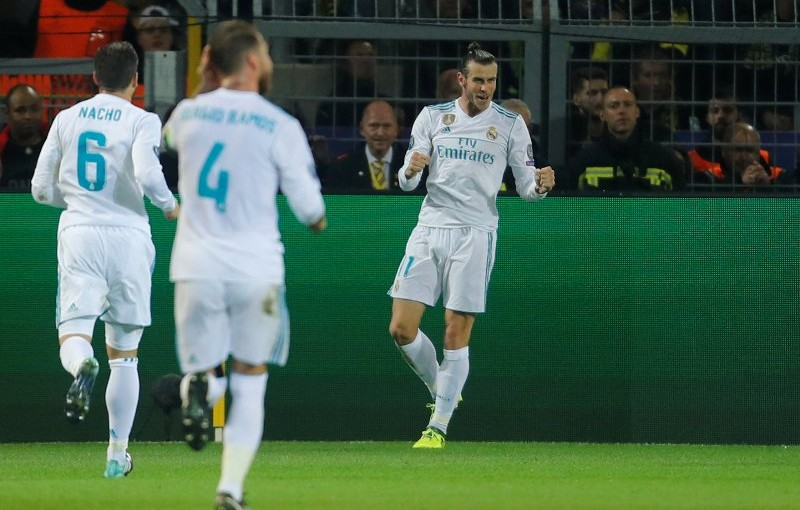 Soccer Football - Champions League - Borussia Dortmund vs Real Madrid - Westfalenstadion, Dortmund, Germany - September 26, 2017   Real Madrid's Gareth Bale celebrates scoring their first goal with Nacho and Sergio Ramos    REUTERS/Leon Kuegeler