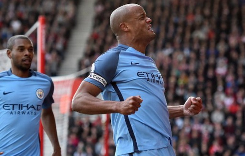 Manchester City's Belgian defender Vincent Kompany celebrates after scoring the opening goal of the English Premier League football match between Southampton and Manchester City at St Mary's Stadium in Southampton, southern England on April 15, 2017. / AFP PHOTO / Glyn KIRK / RESTRICTED TO EDITORIAL USE. No use with unauthorized audio, video, data, fixture lists, club/league logos or 'live' services. Online in-match use limited to 75 images, no video emulation. No use in betting, games or single club/league/player publications.  /