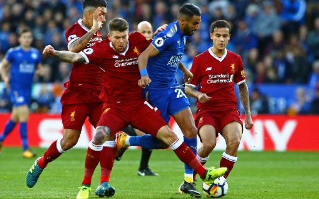 Leicester City's Algerian midfielder Riyad Mahrez (2nd R) is tackled by Liverpool's Spanish defender Alberto Moreno during the English Premier League football match between Leicester City and Liverpool at King Power Stadium in Leicester, central England on September 23, 2017. / AFP PHOTO / Geoff CADDICK / RESTRICTED TO EDITORIAL USE. No use with unauthorized audio, video, data, fixture lists, club/league logos or 'live' services. Online in-match use limited to 75 images, no video emulation. No use in betting, games or single club/league/player publications.  /