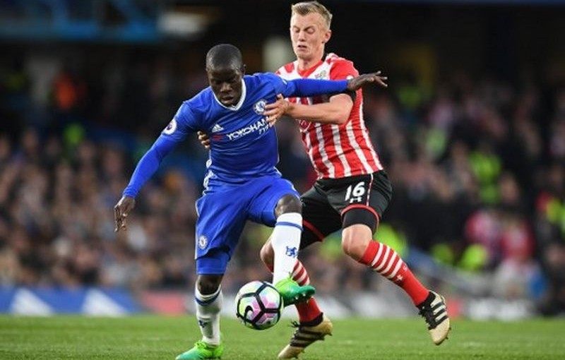 Chelsea's French midfielder N'Golo Kante (L) vies with Southampton's English midfielder James Ward-Prowse during the English Premier League football match between Chelsea and Southampton at Stamford Bridge in London on April 25, 2017. / AFP PHOTO / Justin TALLIS / RESTRICTED TO EDITORIAL USE. No use with unauthorized audio, video, data, fixture lists, club/league logos or 'live' services. Online in-match use limited to 75 images, no video emulation. No use in betting, games or single club/league/player publications.  /