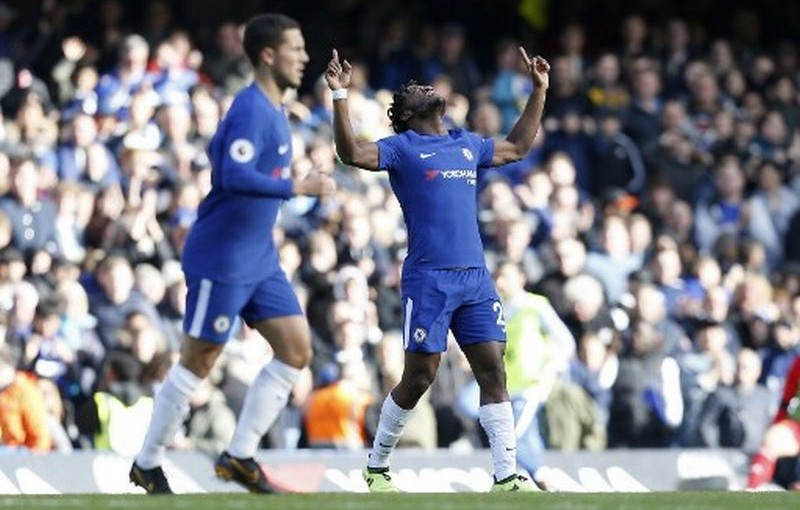 Chelsea's Belgian striker Michy Batshuayi (R) celebrates scoring his team's second goal during the English Premier League football match between Chelsea and Watford at Stamford Bridge in London on October 21, 2017. / AFP PHOTO / Ian KINGTON / RESTRICTED TO EDITORIAL USE. No use with unauthorized audio, video, data, fixture lists, club/league logos or 'live' services. Online in-match use limited to 75 images, no video emulation. No use in betting, games or single club/league/player publications.  /