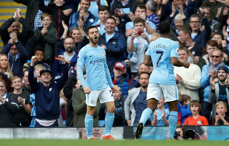 """Soccer Football - Premier League - Manchester City vs Stoke City - Etihad Stadium, Manchester, Britain - October 14, 2017   Manchester City's Bernardo Silva celebrates scoring their seventh goal    REUTERS/Andrew Yates    EDITORIAL USE ONLY. No use with unauthorized audio, video, data, fixture lists, club/league logos or """"live"""" services. Online in-match use limited to 75 images, no video emulation. No use in betting, games or single club/league/player publications. Please contact your account representative for further details."""